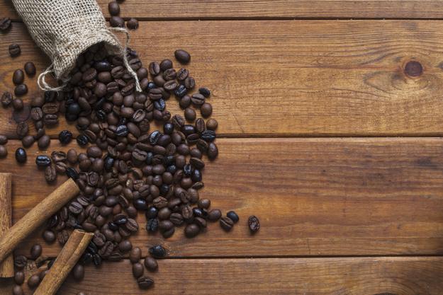 cinnamon-near-spilled-coffee-beans_23-2147764898